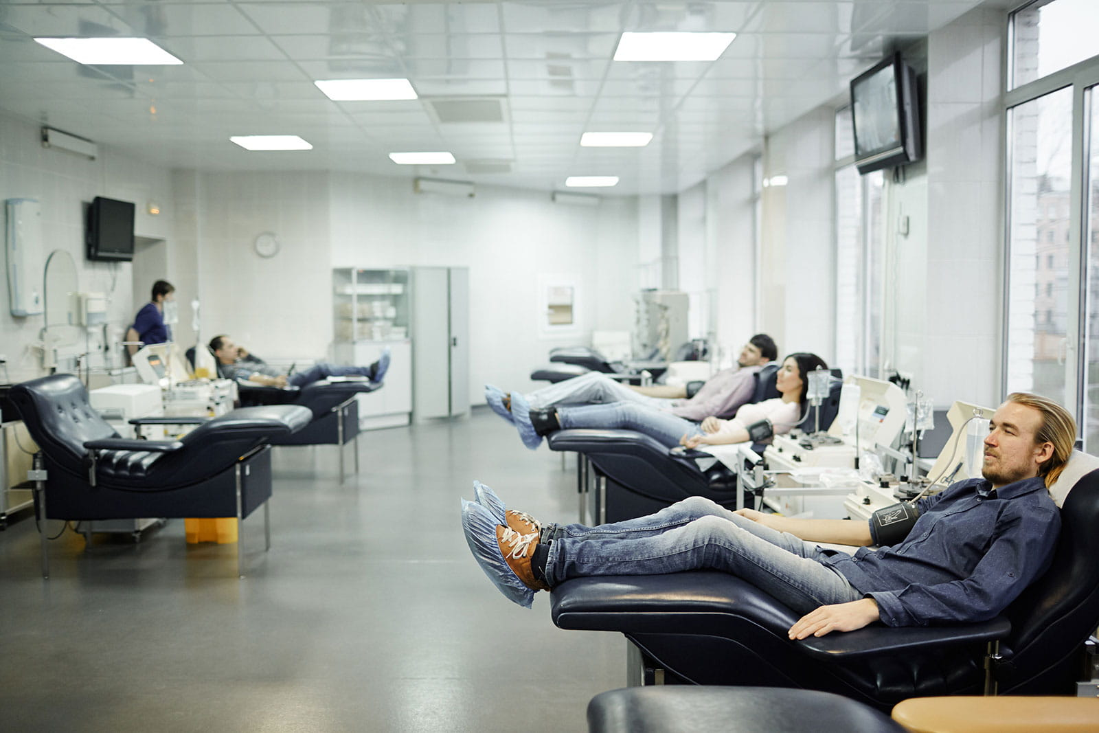 People donating blood in a donation center